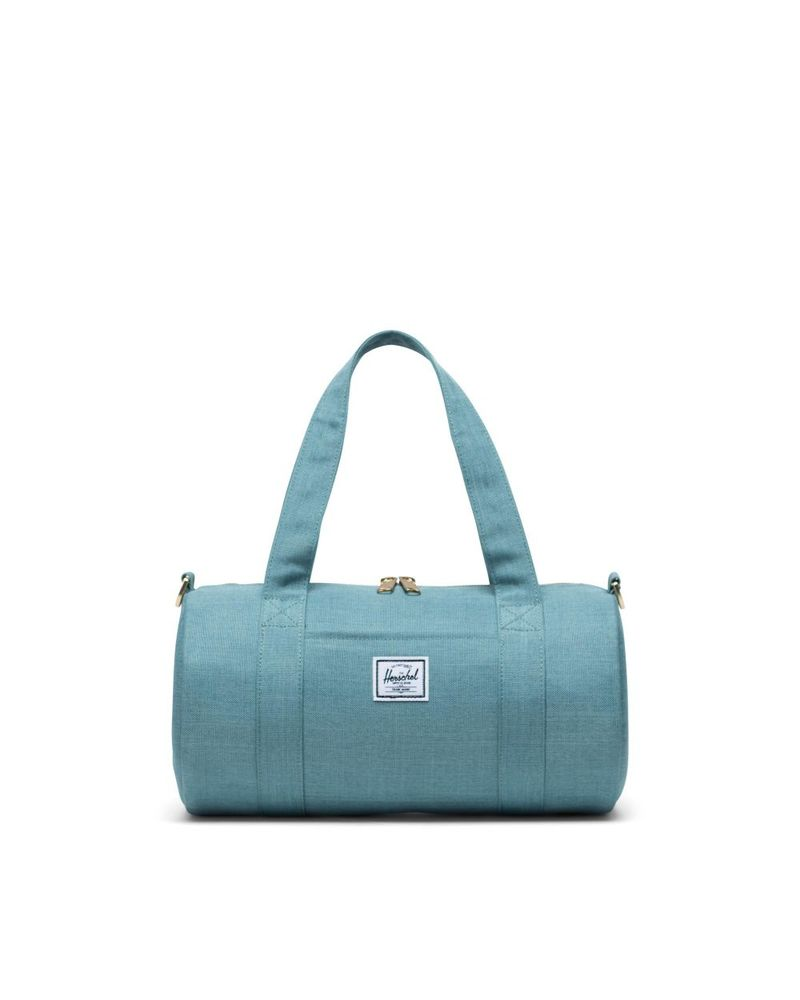 Taška HERSCHEL Sutton Mini Oil Blue Crosshatch